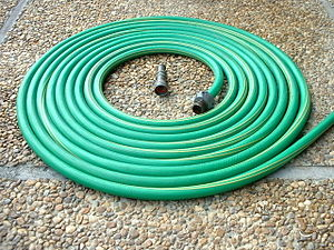 Garden hose - A neatly coiled garden hose