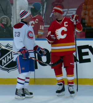 Craig Conroy - Conroy (right) talks with former teammate Martin Gélinas during the alumni game at the 2011 Heritage Classic.