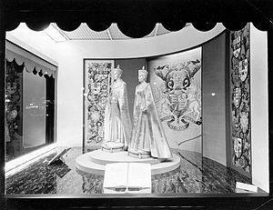 Coronation of King George VI and Queen Elizabeth - Eaton's department store window in Toronto displaying mannequins of George and Elizabeth wearing their crowns and holding orbs