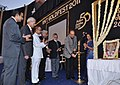 Ghulam Nabi Azad lighting the lamp at the Golden Jubilee Meet of the Ravindra Nath Tagore Medical College, Udaipur in Rajasthan. The Union Minister for Road Transport and Highways, Dr. C.P. Joshi is also seen.jpg