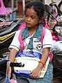 Girl in School Uniform on Motorbike - Stung Treng - Cambodia (48422284276).jpg