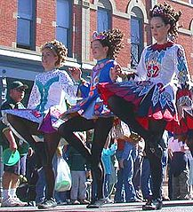 Girls performing Irish step dancing in a St. Patrick's Day Parade in Fort Collins, Colorado.jpg