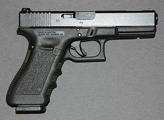 "Glock - A ""third-generation"" Glock 17C, identified by the addition of an extra cross pin above the trigger, a reshaped extractor that serves as a loaded chamber indicator, and an accessory rail"