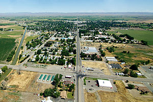 An aerial view of Gooding, Idaho, from the South. The road in the middle of the photo is Highway 46.