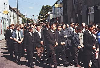 Corpus Christi procession in Tipperary in 1963 Group of men, Corpus Christi procession, Cahir, Co. Tipperary (21890973583).jpg