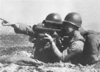 Gunner aiming mini-Redeye from foxhole.png