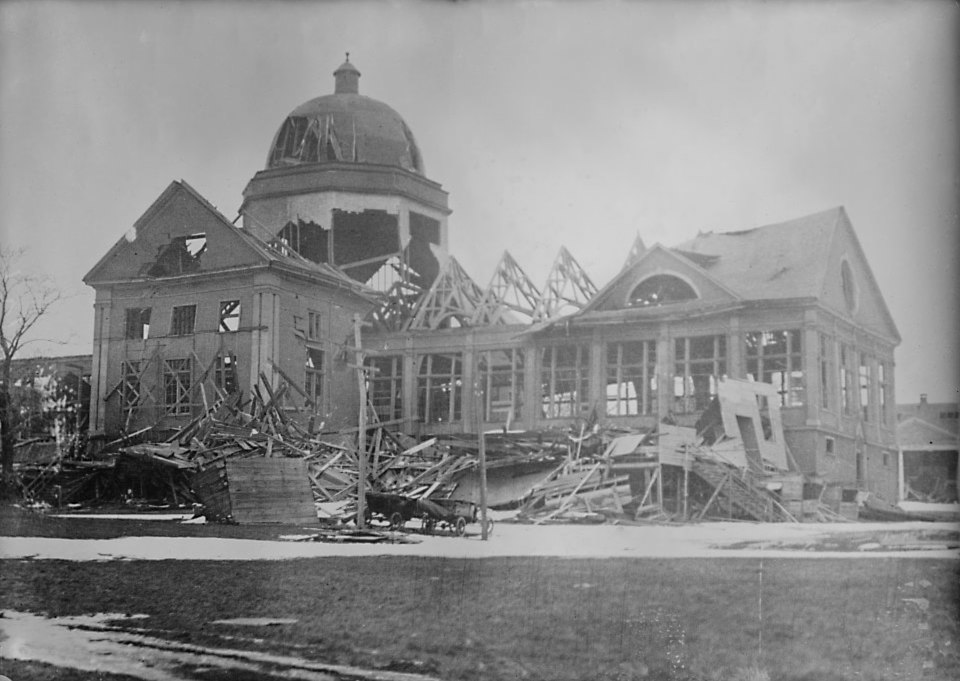 Large building with windows and part of roof missing