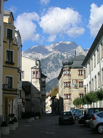 Hall in Tirol - A street in the old town with Mount Bettelwurf in the background