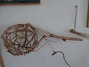 Beekeeping in India - A hand held bamboo basket at display in the Honey and Bee Museum, Ooty. The basket was used to harvest honey by honeyhunters.