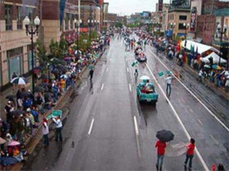 Hennepin Avenue - The 2002 GLBT Pride Parade on Hennepin Avenue, photographed from the skyway. The intersection shown is 9th and Hennepin, the subject of a song by the same name by Tom Waits.
