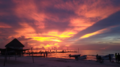 Holbox beach sunset with light rays 2019.png