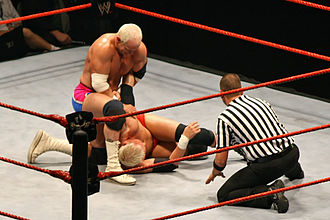 Hardcore Holly - Holly with an armbar locked firmly on Mr. Kennedy