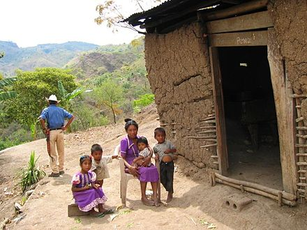 An indigenous family in a small mountain village in Honduras Honduras house copan.jpg