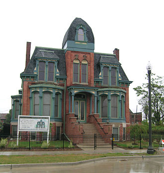 Economy of metropolitan Detroit - Historic restoration of the Second Empire style Frederick Butler House (1882), 8,400 square ft., at 291 Edmund Place in Brush Park (Woodward East), completed in 2006.
