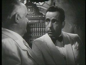 This screenshot shows Humphrey Bogart in a con...