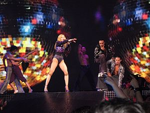 "Hung Up - Madonna performing the first verse of ""Hung Up"" backed by her dancers, during the Confessions Tour."