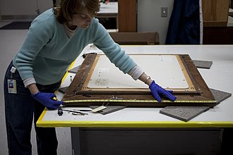 Conservation technician - Indianapolis Museum of Art conservation technician, Laura Mosteller, documents the dimensions of a frame.
