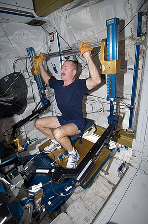 Daniel C. Burbank - Burbank exercises in the Tranquility module of the International Space Station.