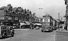 Two west-bound trolleybuses in Romford Road, Ilford, in July 1955.