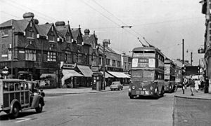 Trolleybuses in London - Two west-bound trolleybuses on Romford Road, Ilford, in July 1955