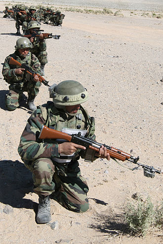 Gorkha regiments (India) - The 1st Battalion of 1 Gorkha Rifles of the Indian Army take position outside a simulated combat town during a training exercise.