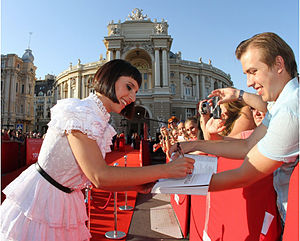 Jamala - Jamala signing an autograph for a fan on the red carpet of the third annual festival of the Odessa Film Festival on July 13, 2012.