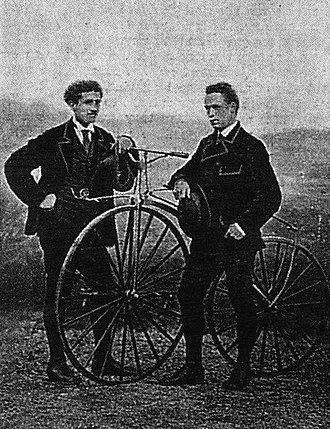 Eugène Meyer (inventor) - James Moore, (right) winner of Paris–Rouen 1869 and Jean-Eugène-André Castera, (left) runner up, posing with a Meyer bicycle