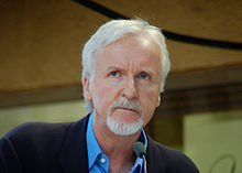 James Cameron, a man in his late fifties with white hair and a goatee, pictured from the shoulders up