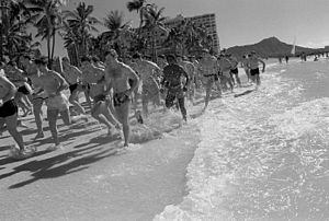 Jogging - Members of the United States Air Force Academy American football team jog on Waikiki beach, Hawaii.