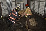 Joint Base Andrews Fire Explorer Academy cadets find a simulated victim mannequin.jpg