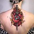 Karolina Wilczewska Rose Dagger Tattoo.jpg