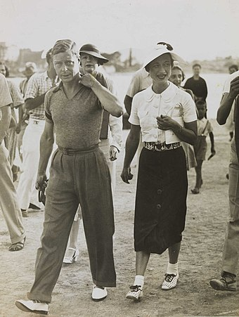 Edward VIII and Wallis Simpson in 1936. His proposal to marry her led to his abdication, an act that required the consent of the Dominions. King Edward VIII and Mrs Simpson on holiday in Yugoslavia, 1936.jpg