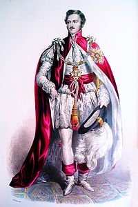 Knights Grand Cross wear their mantles over suits in modern times. During the nineteenth century, as depicted above, they wore them over imitations of seventeenth century dress.