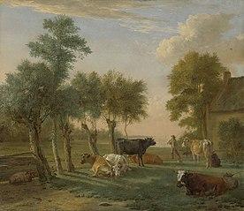 Vaches dans un pré près d'une ferme