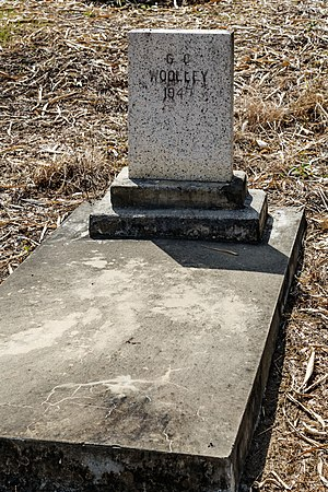 George Cathcart Woolley - Woolley's tombstone at the old Anglican cemetery in Kota Kinabalu