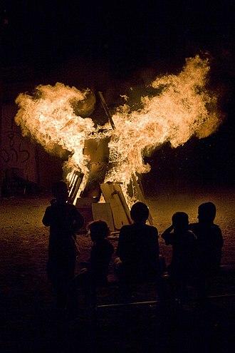 Lag BaOmer - Children watch Lag BaOmer bonfire in Tel Aviv, Israel.