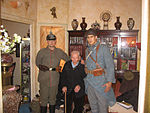 Lazare Ponticelli (center) between two reenactment members in old uniforms in 2006