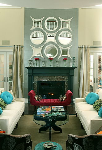 Hollywood Regency - Living room in Hollywood Regency style, drawing on its tendency to favor turquoise, mirrors, and strong dark/ white contrasts