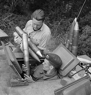 Ordnance QF 75 mm - Loading ammunition into a Churchill tank, Normandy July 1944