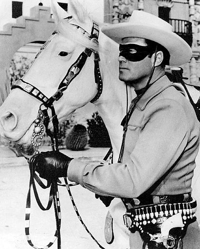 "The Lone Ranger; a famous heroic lawman who was with a cavalry of six Texas Rangers, until they were all killed but him. He preferred to remain anonymous, so he resigned and built a sixth grave that supposedly held his body. He fights on as a lawman, wearing a mask, for, ""Outlaws live in a world of fear. Fear of the mysterious."" Lone ranger silver 1965.JPG"