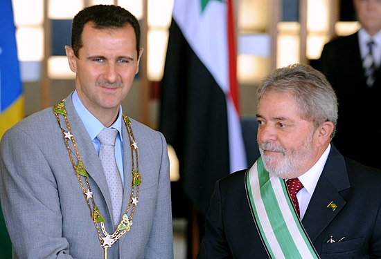 "Bashar al-Assad wearing the ""Grand Collar"" of the National Order of the Southern Cross, accompanied by Brazilian President Luiz Inacio Lula da Silva in Brasilia, 30 June 2010 Lula Al-Assad Itamaraty 2010.jpg"
