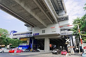 MRT Bang Khun Non – Station with a street-level train crosssing arm 2.jpg