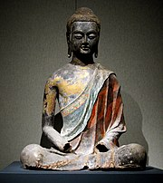 A Chinese Tang Dynasty (618-907) sculpture of the Buddha seated in meditation.