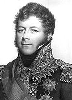 Black and white print of a confident-looking man with long sideburns. He wears a dark military uniform with a high colour and many decorations.
