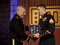Marine Corps Sgt. Andrew C. Seif, right, receives the USO Marine of the Year award from the Assistant Commandant of the Marine Corps, Gen. John M. Paxton, Jr., during the 2013 USO Gala in Washington, D.C 131025-M-KS211-019.jpg