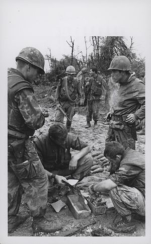 Operation Taylor Common - Marines inspect a PAVN ammunition cache
