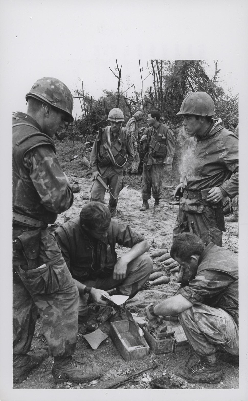 Marines Inspect Enemy Ammunition, 1969 (20524088458)