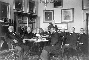 Presidency of William McKinley - President McKinley and his cabinet, 1898 At far left: William McKinley. Left to right in back of table: Lyman J. Gage, John W. Griggs, John D. Long, James Wilson standing, and Cornelius N. Bliss. Left to right in front of table: John Hay, Russell A. Alger, and Charles E. Smith
