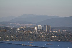 Medina, pictured front just after the Evergreen Point Floating Bridge, with the Bellevue skyline behind