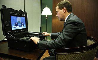 Tandberg - Dmitry Medvedev with TANDBERG Tactical MXP. APEC Singapore 2009